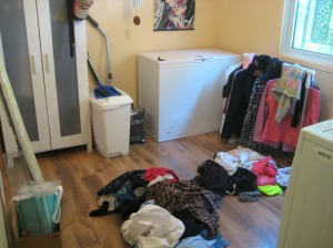 Nowhere to sort clothes except the floor